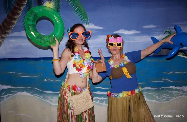 Our beach photo backdrop available to hire as an optional extra.